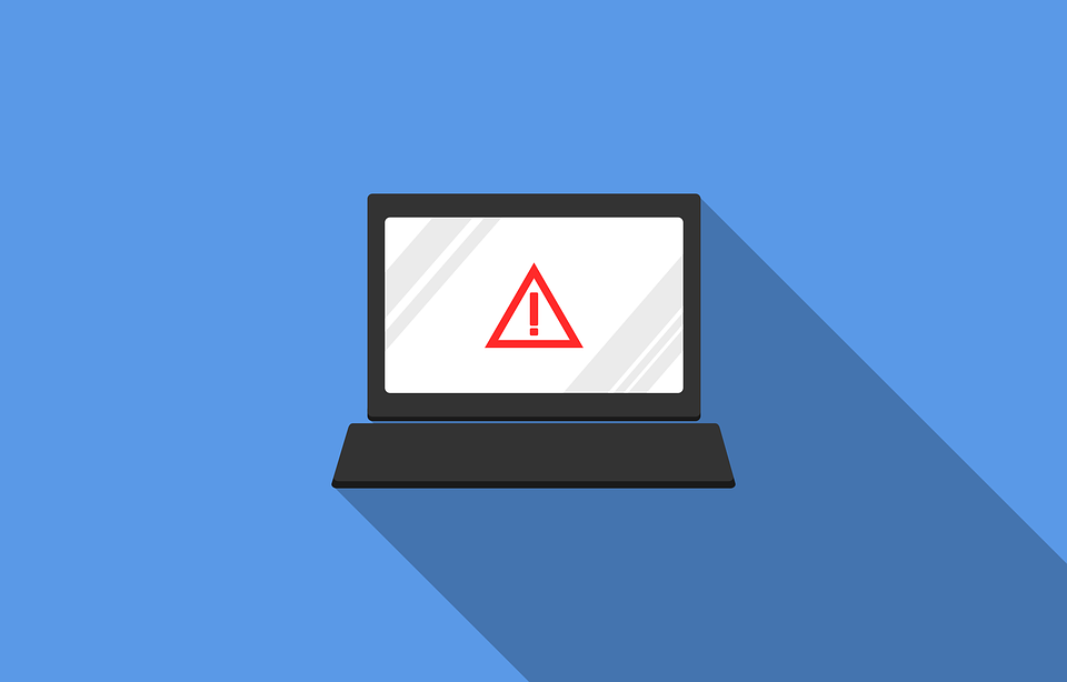 A laptop with a large warning icon