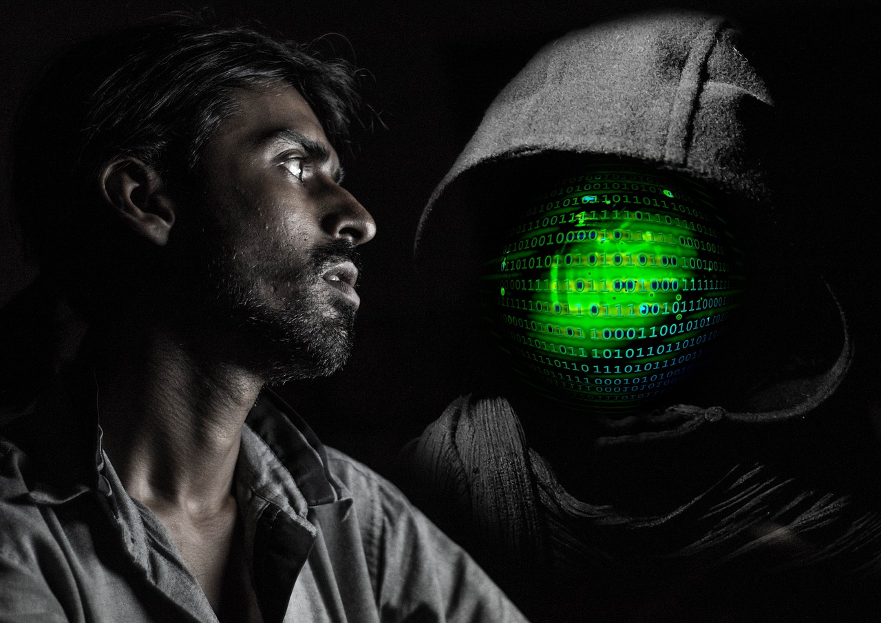 A man looking seriously at a personification of a malignant network in a hoody. (Yeah, that's really what the image is.)