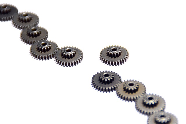 A broken line of gears with the missing gear off to the side.